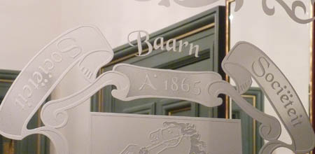 Zandstralen van logo's en familiewapens